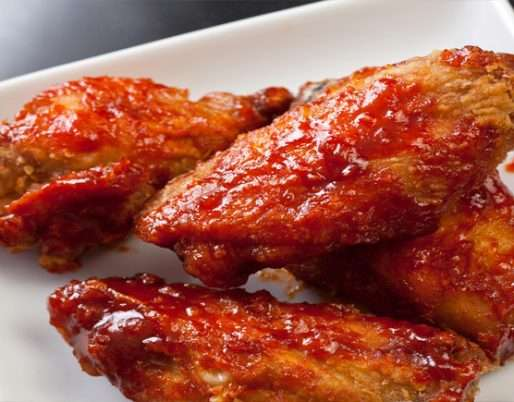 Buffalo wings Coated in Spicy Sauce Recipe